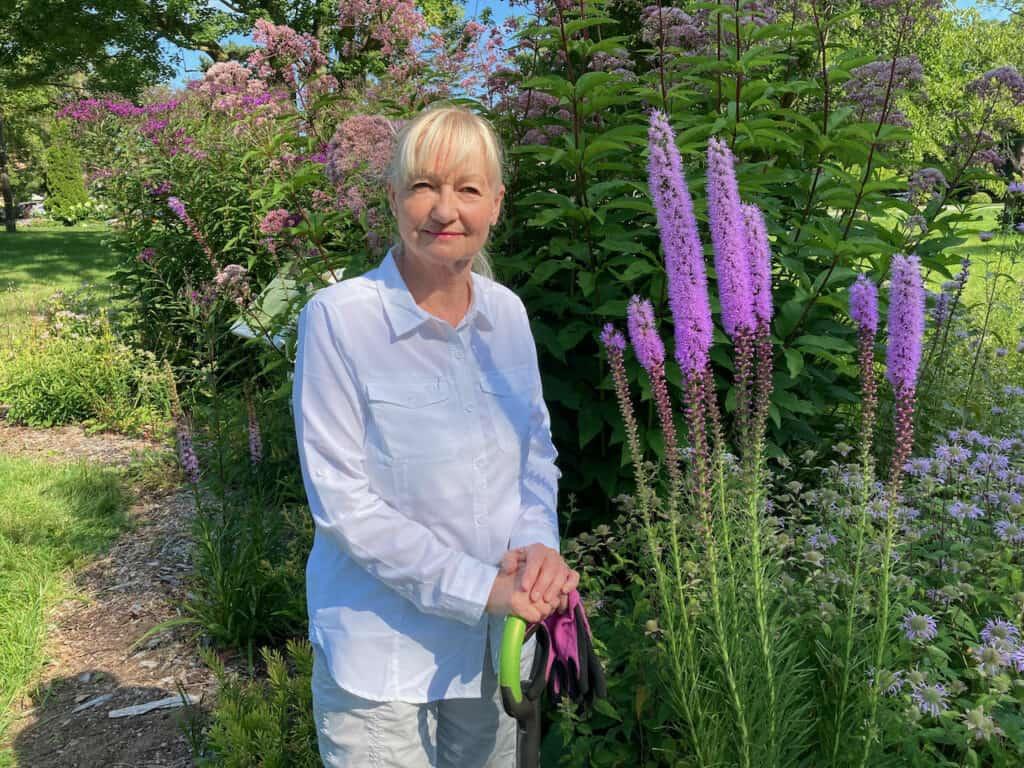 Klara Young-Chin in pollinator garden July 2021